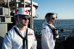 Sailors stand watch during a sea-anchor-detail aboard the USS Chief