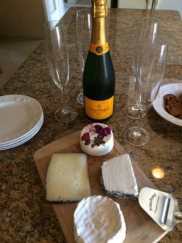 Veuve Clicquot and our cheese board filled with Sea Spring Island chevre, Pave de Jadis, Delice de Cremiers, and Cinco Lanzas