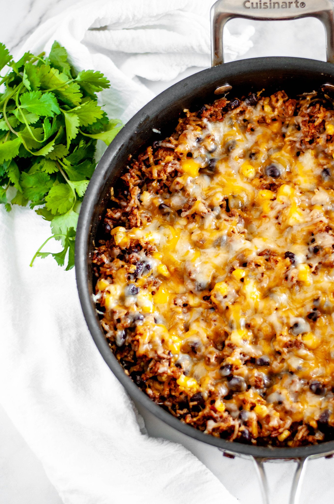 This Cheesy Mexican Skillet is done in 30 minutes for the perfect weeknight meal. Packed full of Mexican flavor from enchilada sauce, cumin, chili powder and more.