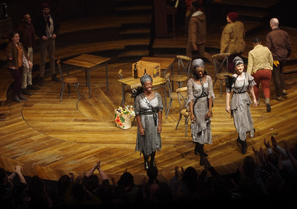 "Several women cast members performing a number from ""Hadestown""."