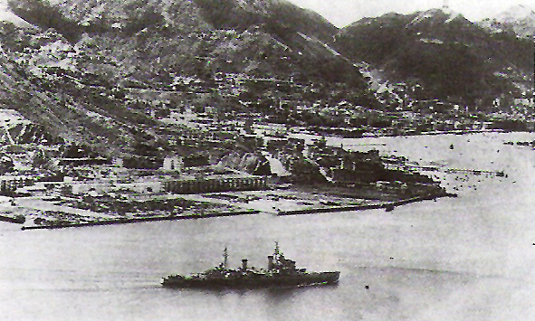 The Royal Navy cruiser HMS Swiftsure (08), entering Victoria Harbour, Hong Kong, through North Point on August 30, 1945.