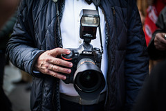 Pro photographer with his finger on the release button. Always prepared