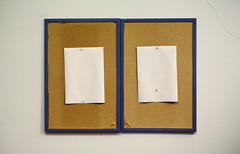 Two Cork Frames With Blank White Papers