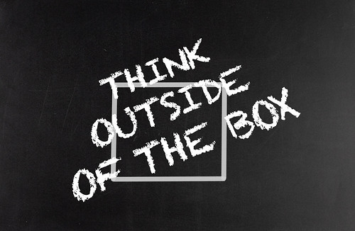 Think outside of the box text on blackboard | by wuestenigel