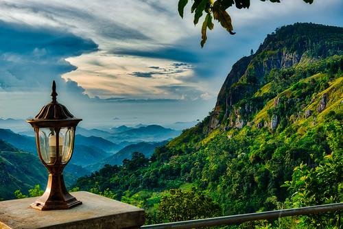 lamp lka cloudscape mountaintop nature yobelmuchang srilanka dense trees mountain jungle nikon muchang dramaticsky 2018 lantern outdoors nikond810 foreground yobel sunrise ella uvaprovince lk