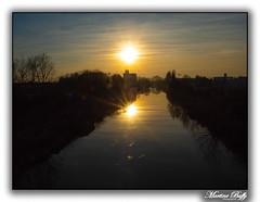 Coucher de soleil dans l'axe du canal