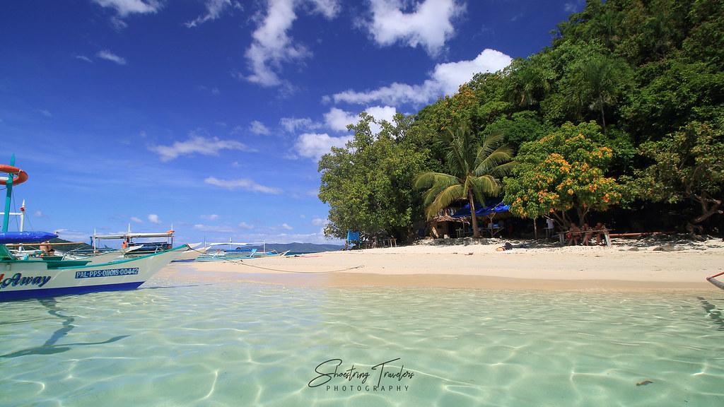 white sand beach at Paradise Island, Port Barton
