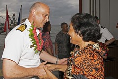 A Marshallese representative places a lei on Royal Navy Capt. Paddy Allen, director of mission, following the Pacific Partnership opening ceremony aboard USNS Brunswick (T-EPF 6). (U.S. Navy/MC1 Tyrell K. Morris)