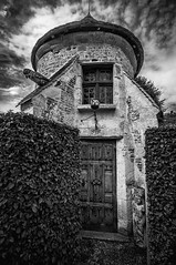black & white study of a charming little detatched tower / doocot at Château de Boutemont, Ouilly-le-Vicomte, Calvados, Normandy, France - Photo of Le Torquesne