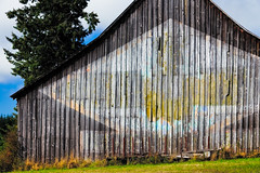 old western barn with close up of the faded logo