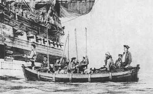 The rescued Selkirk, seated at right, being taken aboard Duke.