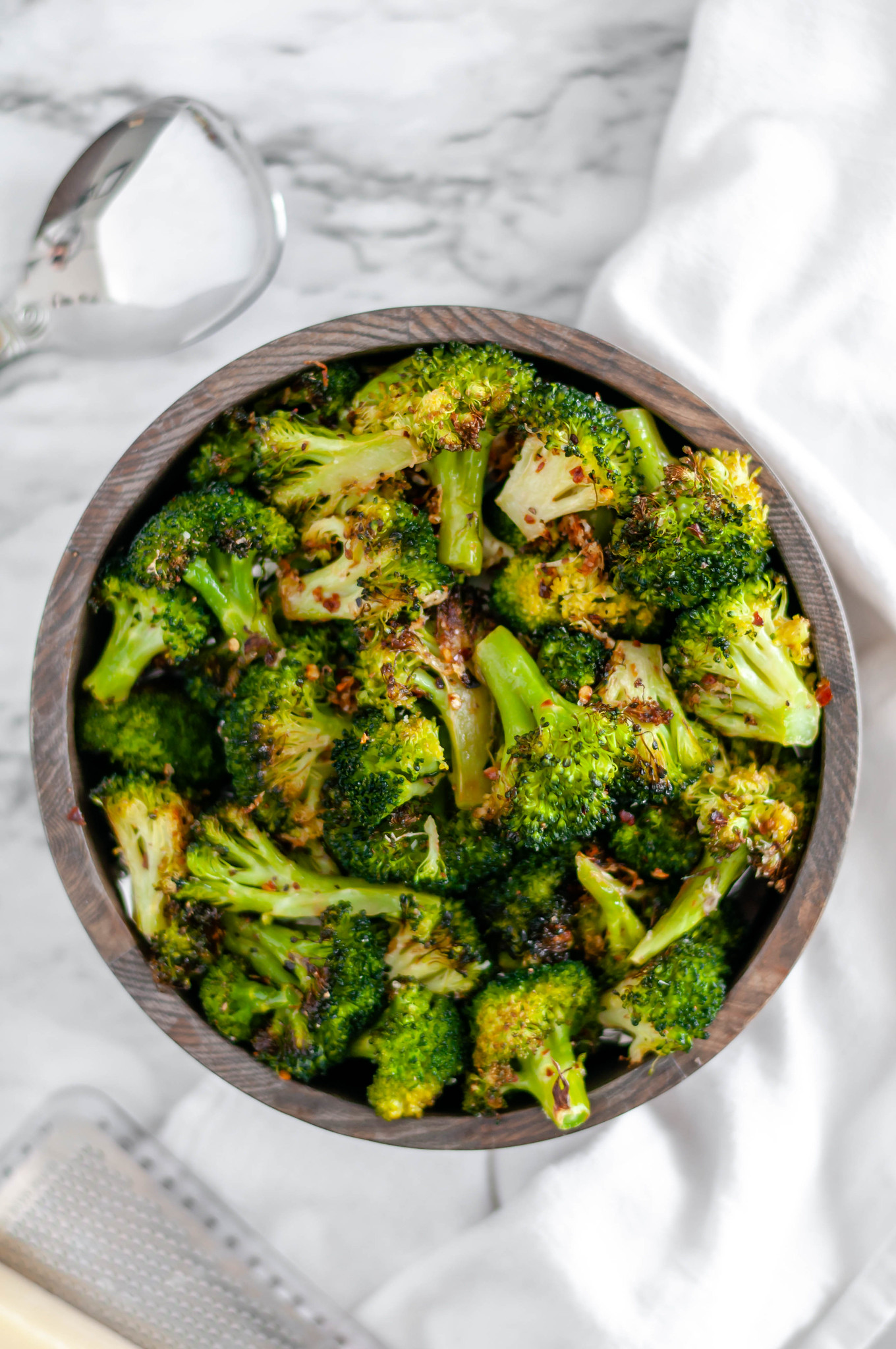 This Spicy Parmesan Roasted Broccoli is a great option for a weeknight side dish. Four simple ingredients are all you need to get this on the table.