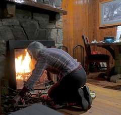 Building a fire in a stone fireplace
