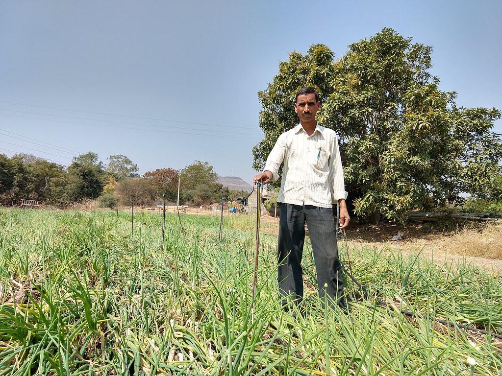 Ganpat Jagtap on his farm in Randullabad, Maharashtra. (Photo by Manu Moudgil)