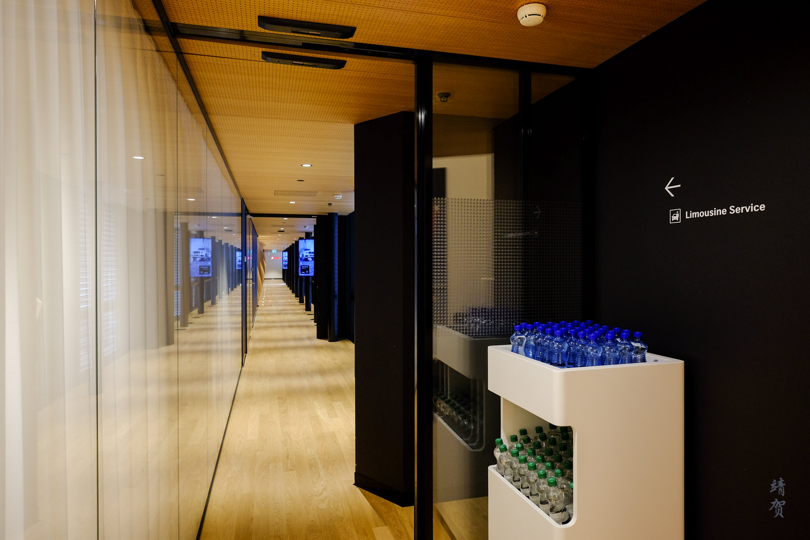 Walkway to Limo area with bottled water cabinet