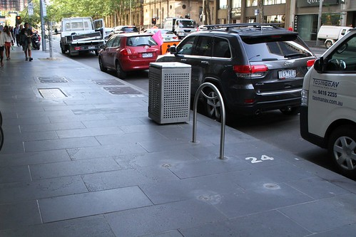 A year after the City of Melbourne said they would move them, the bike hoops at William and Bourke Street are now parallel to the kerb, instead of blocking the footpath