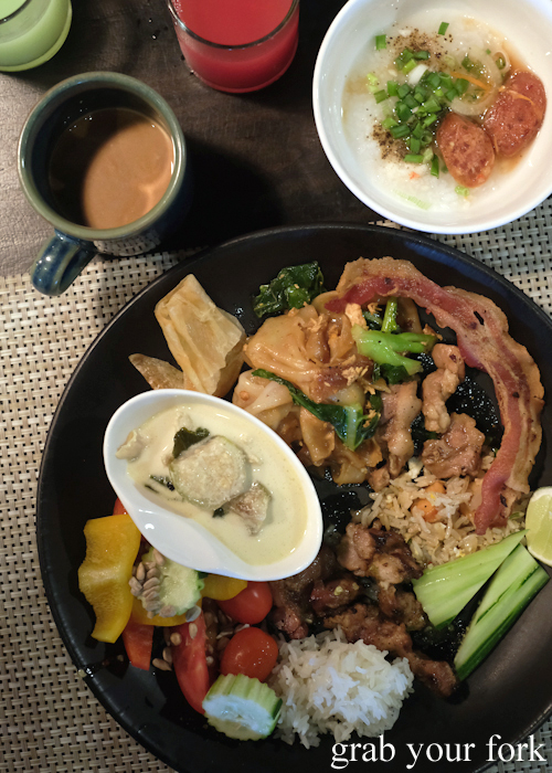 Buffet breakfast of congee and green curry chicken at La Vela Hotel Resort in Khao Lak, Thailand