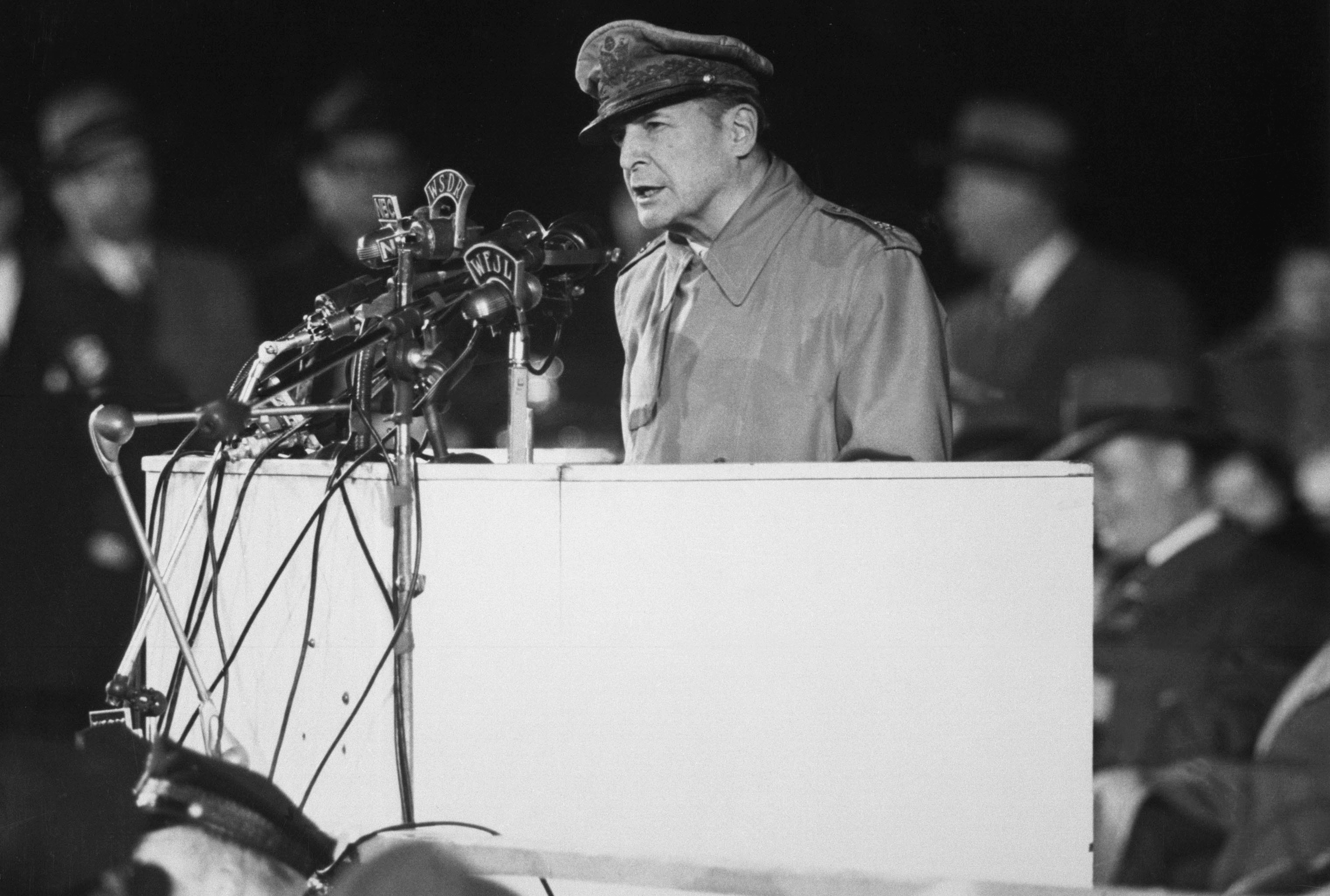 General Douglas MacArthur addressing an audience of 50,000 at Soldier's Field, Chicago, on his first visit to the United States in 14 years, April 25,1951. NARA FILE #: 306-PS-51-6988.WAR & CONFLICT BOOK #: 1377
