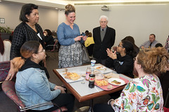 Rep. Stephanie Cummings talks with Crosby High School students Samantha Martinez, Yosmeiris Castro and educator Kelly Donohue as Superintendent of Waterbury Schools Verna Ruffin and Board of Education member Charles Stango look on during a lunch break on CABE advocacy day at the Capitol.