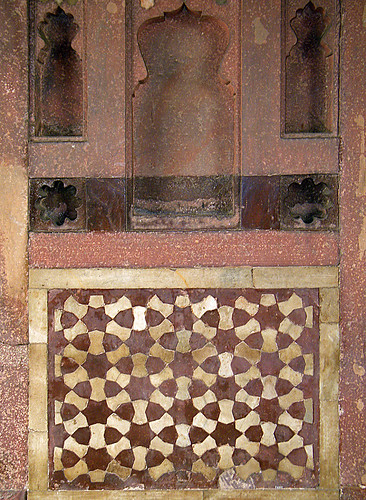 Geometric tile patterns and three niches at the Baby Taj, aka Itimad-ud-Daulah, a Mughal structure built completely from marble containing the tomb of the Persian nobleman