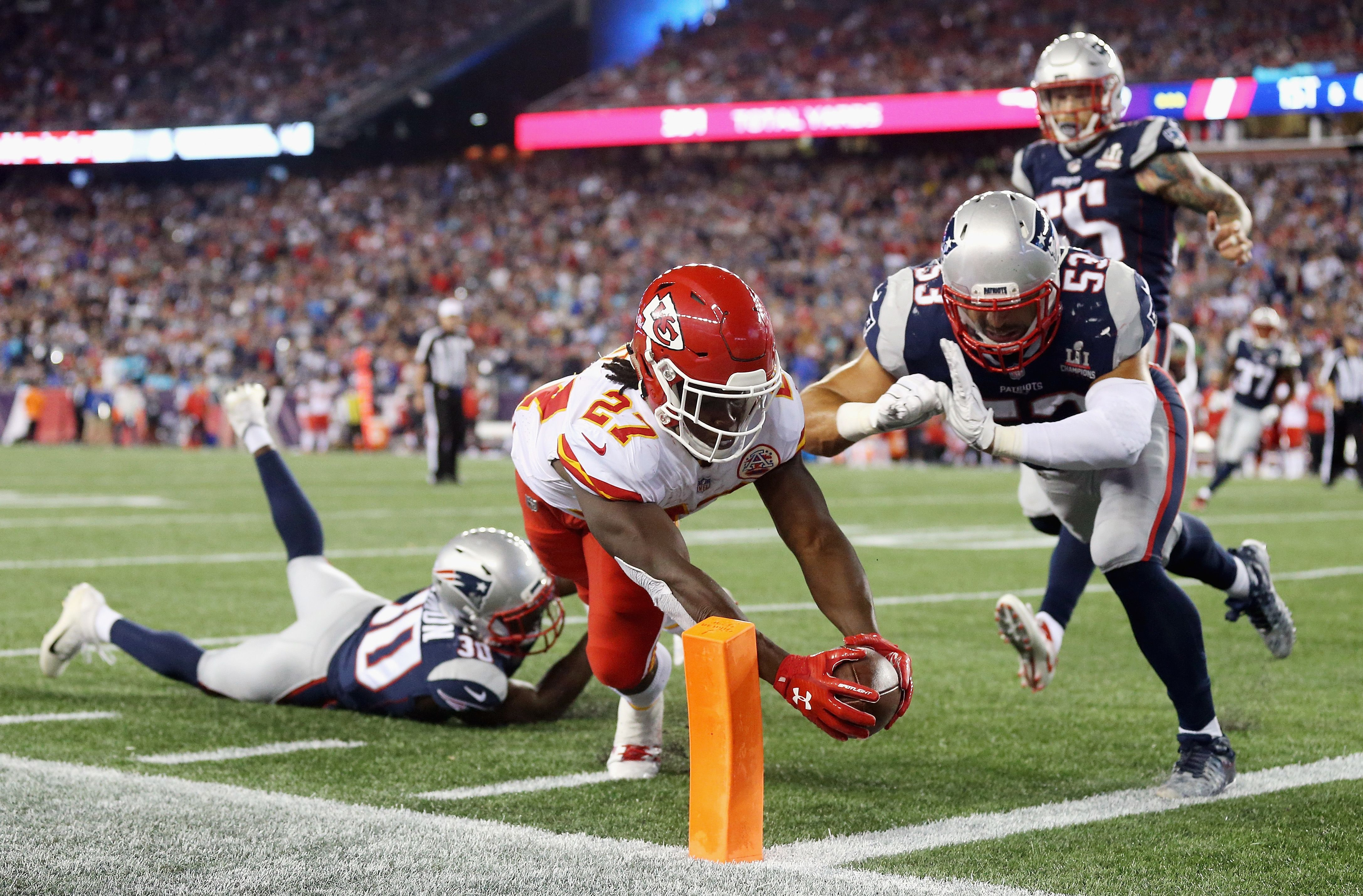 Kareem Hunt #27 of the Kansas City Chiefs dives for the pylon to score a 4-yard rushing touchdown during the fourth quarter against the New England Patriots at Gillette Stadium on September 7, 2017 in Foxboro, Massachusetts. (Photo by Maddie Meyer/Getty Images)