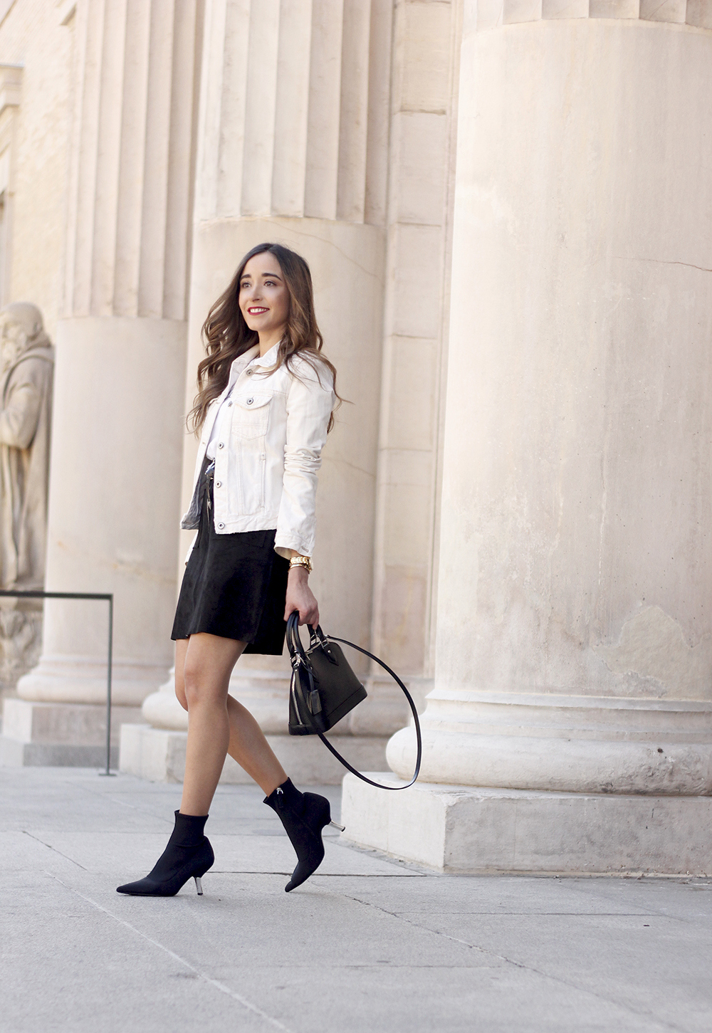 suede black skirt uterqüe ankle boots denim jacket louis vuitton bag street style outfit 20191
