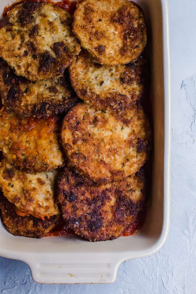 For egplant parmesan recipe, layer fried eggplant slices with marinara sauce.