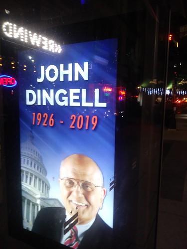 John Dingell appreciation ad on his death, bus shelter, Connecticut Avenue NW, Washington, DC