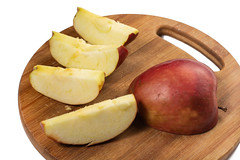 Sliced Red Apple on the wooden board