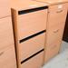 Beech three door filing cabinet with keys E125