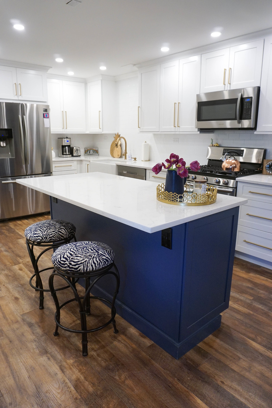 White Kitchen Cabinets Gold Hardware Blue Island Cabinets White Countertops Stainless Steel Appliances