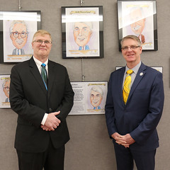 Rep. Ackert and Positive Expression co founder David Trmik in front of Positive Expression's ' Leadership Matters' exhibit