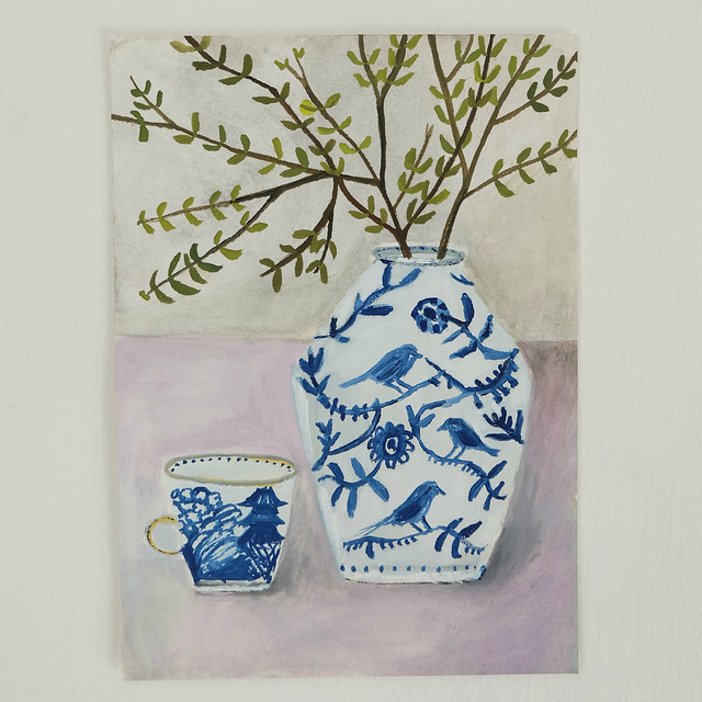 blue and white bird jar