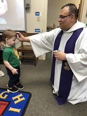 Fr. Juan gives ashes to preschool.