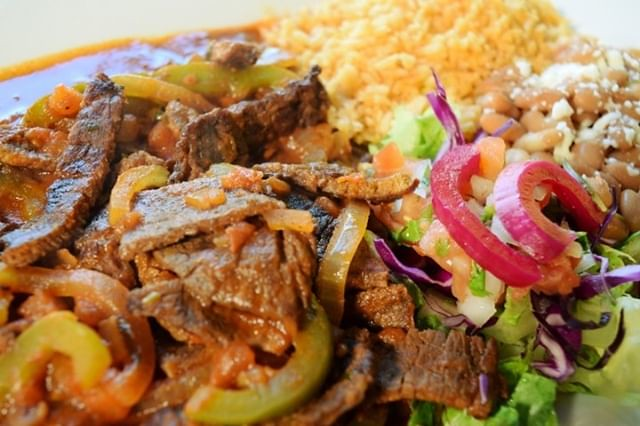 🤔 What's better than a juicy, grilled steak? 🤔 A juicy, grilled steak from La Catrina Tacos & Tequila! � Prepared with zesty, sauteed bell peppers and onions, a hint of jalapeno heat, tomatoes and house red sauce. En
