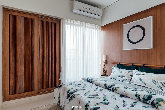 Floral bedding completes this modern bedroom in wooden tones