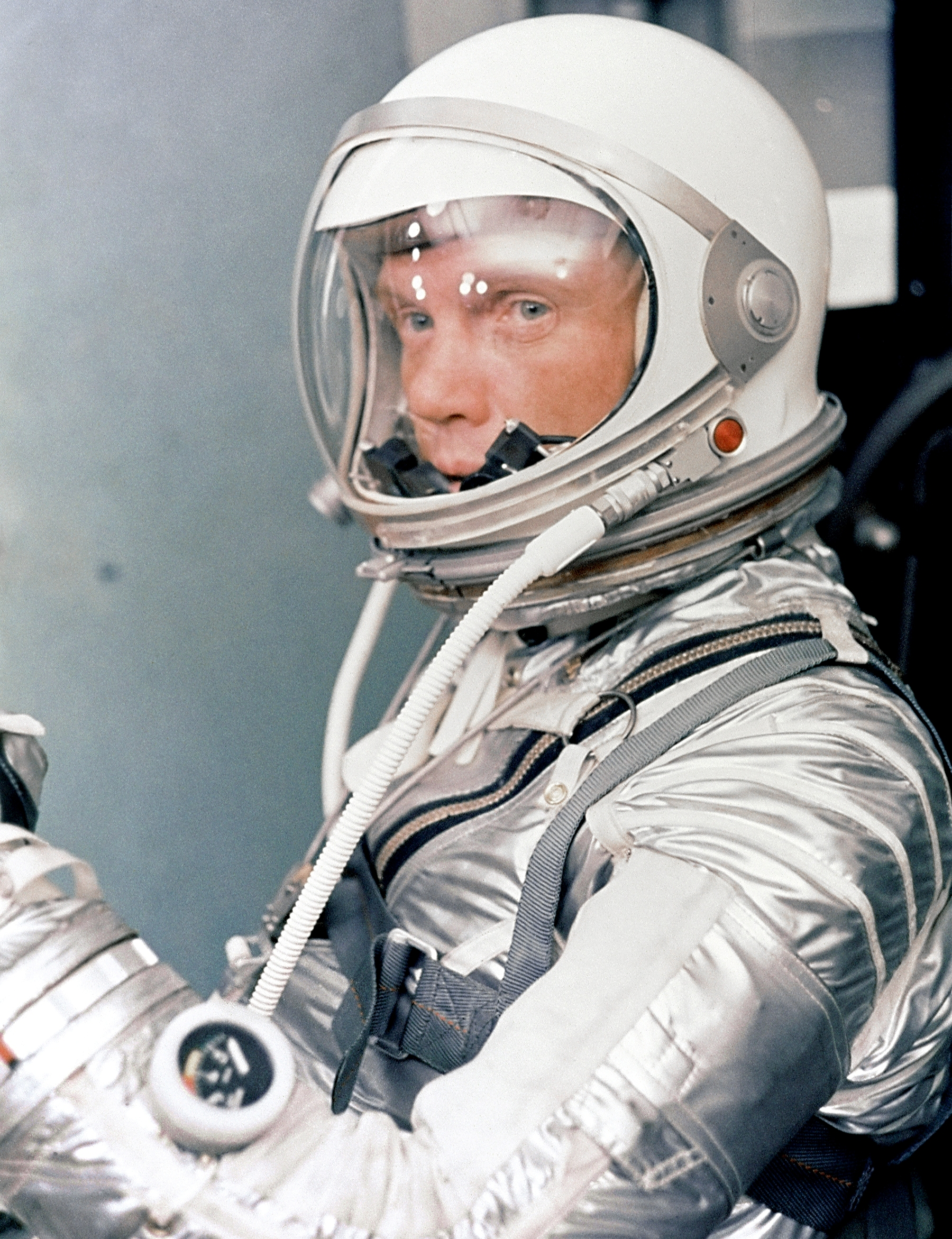 Astronaut John H. Glenn Jr. dons his silver Mercury pressure suit in preparation for launch of Mercury Atlas 6 (MA-6) rocket. Photo taken on January 20, 1962.