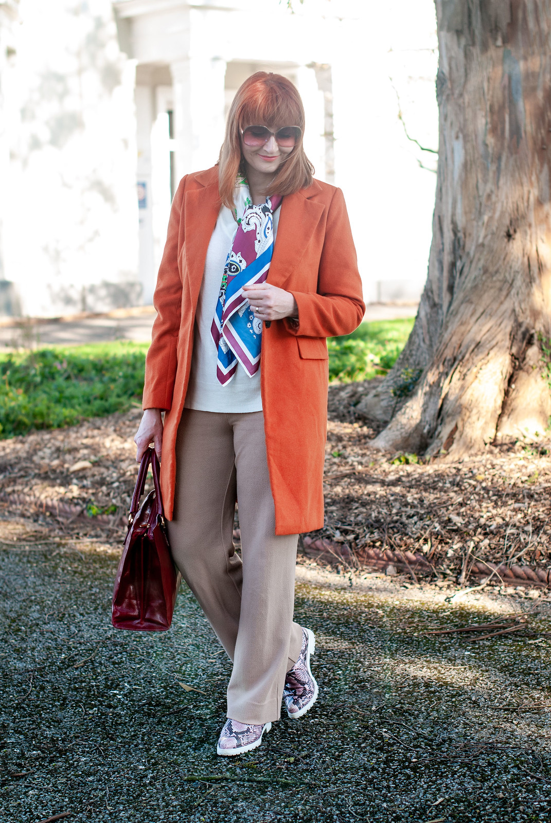 Fashion Over 40: A Longline Coat or Blazer is Your Wardrobe's Best Friend \ longline orange coat \ camel wide leg trousers \ red leather tote bag \ pink snakeskin lace up shoes | Not Dressed As Lamb