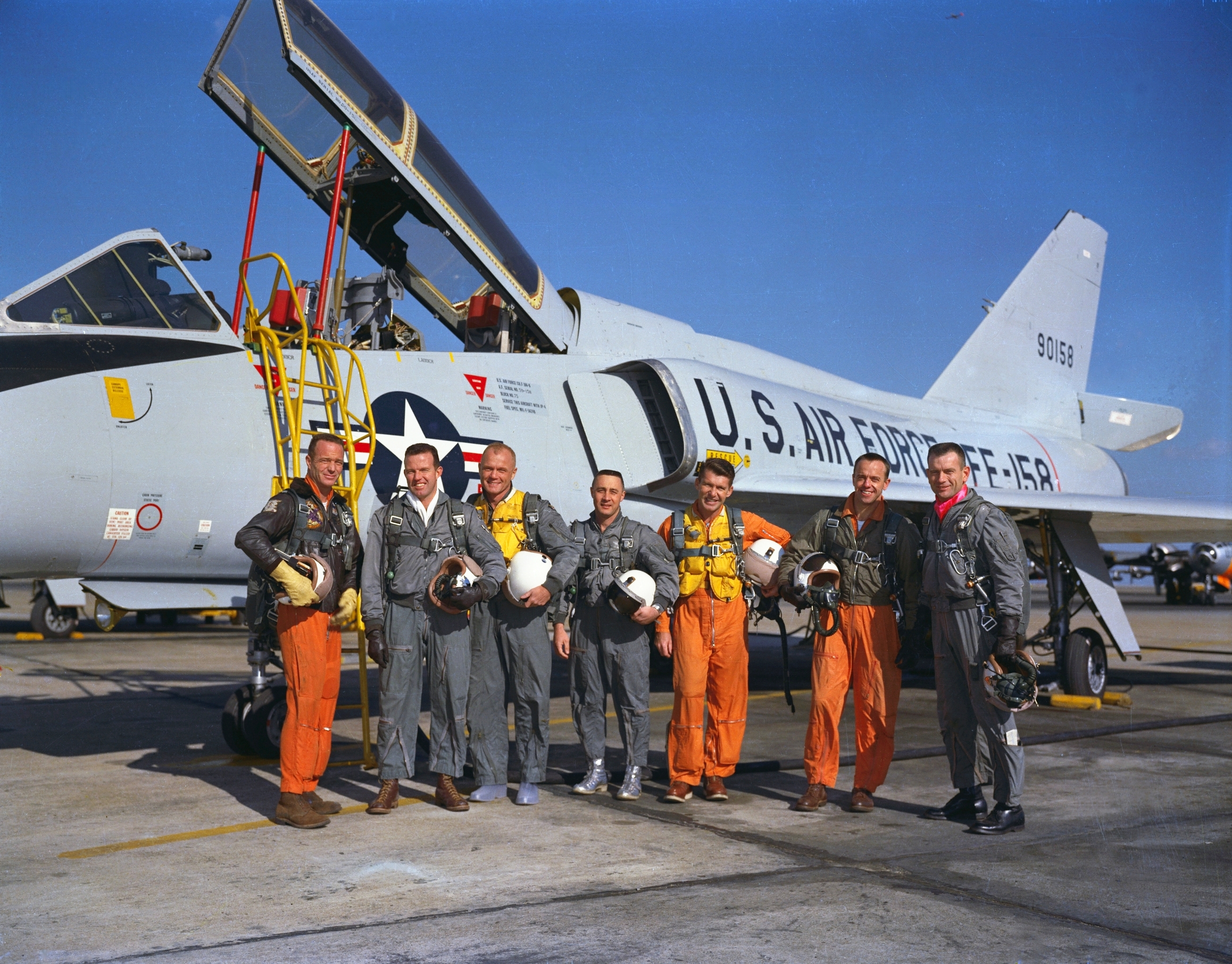 The Mercury Seven astronauts with a Convair F-106B Delta Dart aircraft at Langley Air Force Base. From left to right: Scott Carpenter, Gordon Cooper, John Glenn, Gus Grissom, Wally Schirra, Alan Shepard and Deke Slayton. Photo taken on January 20, 1961.