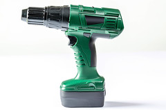 Green drill toy on white background