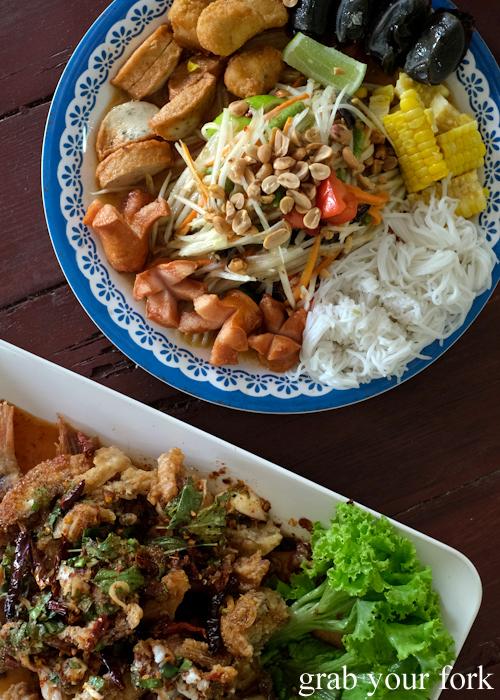 Som tum tray and fried fish with herb salad at Krua Navy Base Restaurant in Khao Lak, Thailand