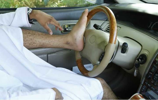 4863 Don't Drive with your Feet – Saudi Police 02