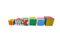 Collection of different Rubik's cubes on white background