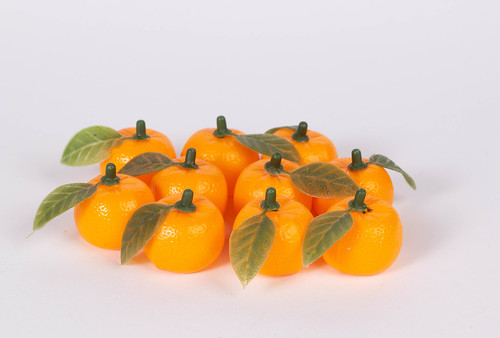 Group of fresh orange fruits on white background | by wuestenigel