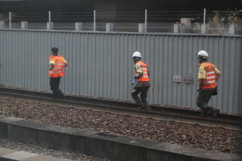 MTR staff at work on the running Tung Chung line tracks north of Kowloon station