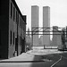 A crop of an old favorite. The clean geometric modernity of the World Trade Center contrasting against the gritty 19th century brick industrial shoreline of Sussex Street by the Hudson River. Jersey City. November 1975 by wavz13