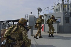 GULF OF THAILAND (Feb. 18, 2019) Royal Marine commandos and Royal Navy sailors attached to the Duke-class frigate HMS Montrose (F 236) conduct a visit, board, search and seizure drill aboard the Henry J. Kaiser-class fleet replenishment oiler USNS Guadalupe (T-AO 200).  During the drill, commandos and sailors coordinated with Guadalupe crew members to simulate maritime interdiction operations and execute proper VBSS procedures. Guadalupe is conducting operations which provides logistical support to U.S. Navy and allied forces operating in the U.S. 7th Fleet area of responsibility. (U.S. Navy photo by Mass Communication Specialist 2nd Class Tristin Barth)