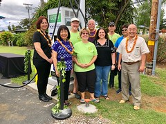 Hawaii Electric Light's Fast Charger Blessing in Punaluu — March 16, 2019: (L-R): General Manager Connie Koi (Punalu'u Bake Shop), President Sharon Suzuki (Maui County and Hawaii Island Utilities), Gary Miller (Big Island Electric Vehicle Association), Pa