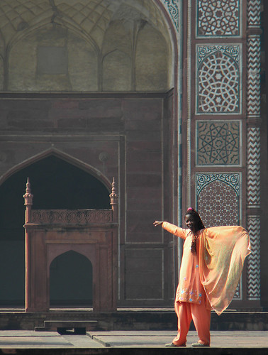 Woman posing in front of Akbar's Mausoleum in Agra, India