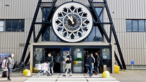 Monumental Railway Station Clock of Den Bosch above the entrance of Jumbo Food Experience in Veghel, the Netherlands